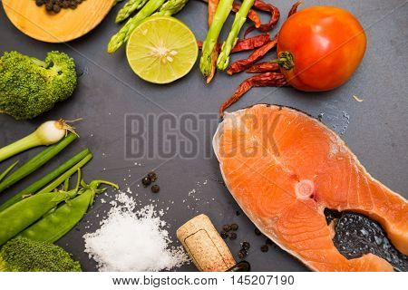 Salmon Fillet On Flat Black Rocks With Lime Chilli Tomato Salt And Vegetable