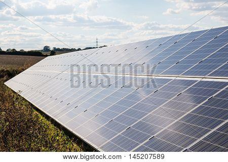 Renewable energy. Long solar panel under cloudy sky