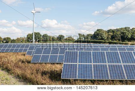 Renewable energy. Solar farm and wind turbine.