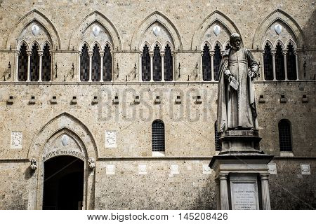 Sculpture in front of the bank Monte dei Paschi in Siena in the tuscany