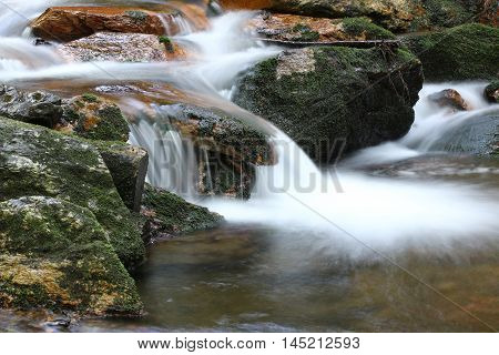 Water flowing over rocks - long exposure Bila Opava Czech republic