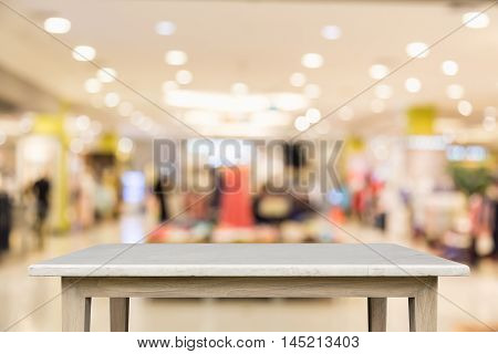 Empty Top Of Natural Stone Table And Blur With Bokeh Background