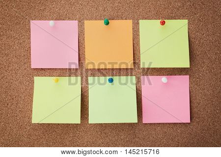 Cork board with notes and pins. Organize and planning concept. Office sticker reminder.
