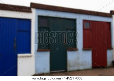 Old disused beach huts on the seafront in Bude Out of focus.