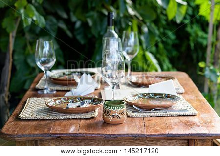 Empty traditional plates with ornaments on a restaurant table in Moldova, after finishing eating