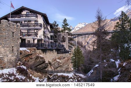 Beautiful modern hotel on the edge of a cliff in the charming Swiss resort of Saas-Fee, Switzerland