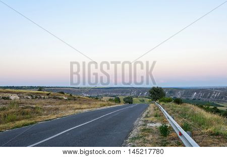 The road to Orheiul vechi memorial complex at sunset in Moldova