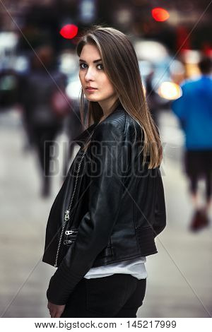 beautiful young woman walking on the crowdy street