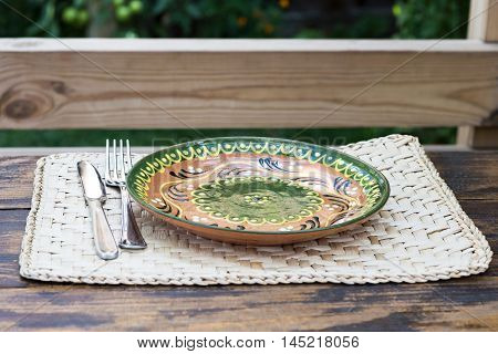 Traditional plate with ornaments on a restaurant table in Moldova