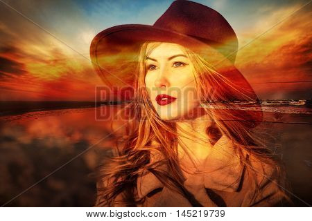 Beautiful woman dreamer on the beach at sunset time. Double exposure.