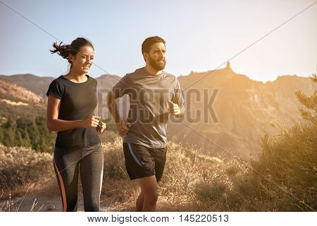 Sweet Young Couple Running In The Mountains