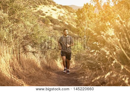 Young Man Running Up A Path