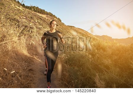 Running Young Female In The Mountains
