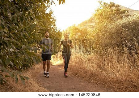 Jogging Young Couple In Natural Shadow