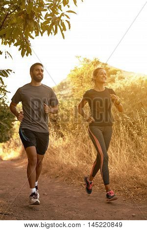 Running Young Couple In Natural Shadow