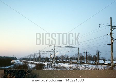 Railway In A Winter Day And Snow Around