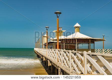 FORTALEZA, BRAZIL, DECEMBER - 2015 - Perspective view of wood breakwater walkway at beach in Fortaleza Brazil