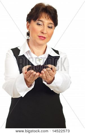 Mature Woman Holding Small Plant