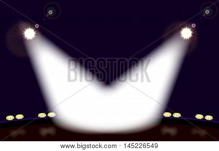 A stage front spot lit by two spotlights