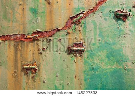 Colorful green stained rust metal texture background.