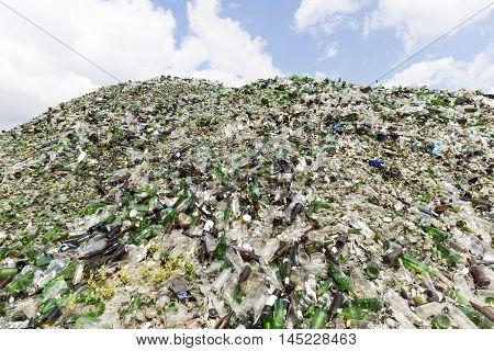 Glass Waste In Recycling Facility. Pile Of Bottles.