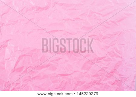 Pink paper wrinkled background, texture and texture