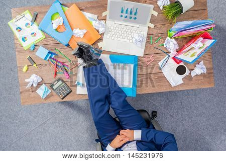 Overhead shot of overworked businessman in blue suit