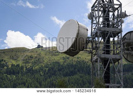 Cell Phone Transmitters On Telecommunication Tower In Livigno Mountains