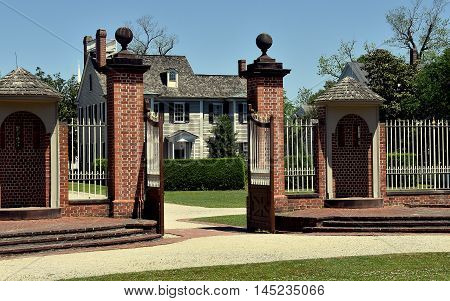 New Bern North Carolina - April 24 2016: 1770 Tryon Palace Entry Gate with dual sentry boxes and 1835 Dixon House