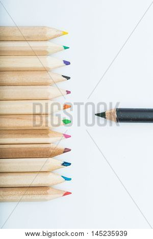 group of wooden crayons. one black crayon