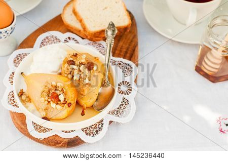 Honey Roast Pears With Granola And Yogurt Stock Photo & Stock Images ...