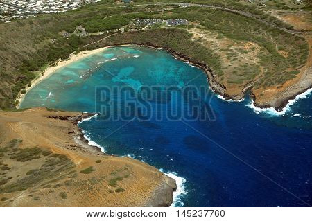 Hanauma Bay Aerial View. Hanauma is a marine embayment formed within a tuff ring and located along the southeast coast of the Island of Oʻahu in the Hawaii Kai neighborhood of East Honolulu in the Hawaiian Islands.
