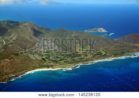 Aerial view of Sandy Beach and Koolua mountains on the south east corner of Oahu with clouds in the sky and off shore islands visible. April 2016.