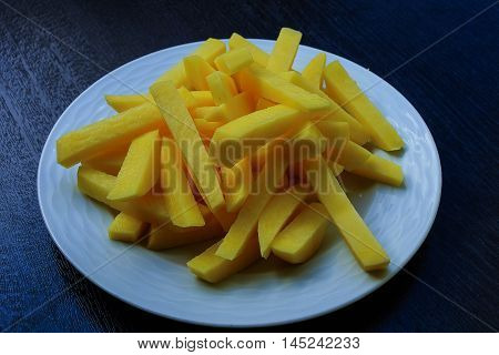 Sliced potatoes ready to fry. Popular french fries.