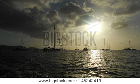 Sailboats anchored in Grenada at sunset in the Caribbean