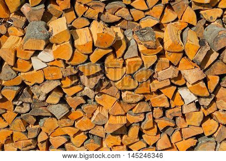 Pile of chopped firewood ready for winter. Background