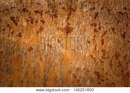 Rusty sheet metal texture - Old rusty metal plate surface very aged and corroded. Image great as background layer or a rusty frame.