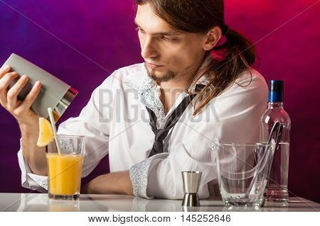 Barman At Counter Makes Drink.