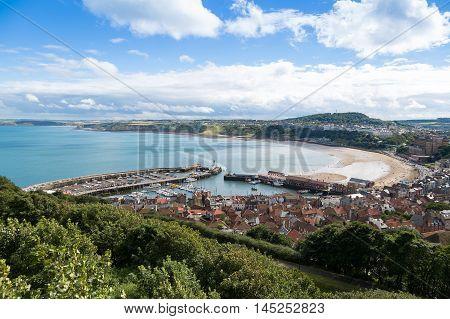 Scarborough harbour and beach a popular tourist destination