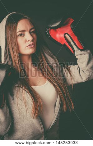 Woman Wear Boxer Gloves With Arms In Air.