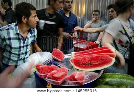 Istanbul Turkey - May 05 2013: Istanbul street sliced watermelon seller Istanbul street sliced watermelon seller a slice of watermelon buyers insanlar in the street.