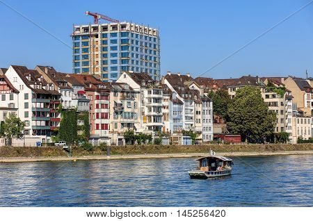 Basel, Switzerland - 27 August, 2016: buildings along the Rhine river view from the Mittlere Rheinbruecke bridge. Basel is a city on the Rhine river in northwestern Switzerland, situated where the Swiss German and French borders meet.