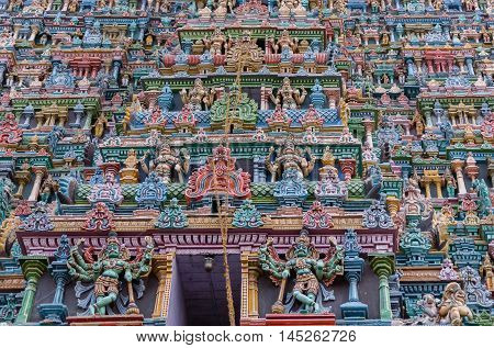 Madurai India - October 19 2013: Closeup of part of the North Gopuram facade. Among many more statues two eight-armed Dwarapalakas.
