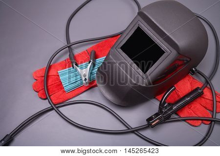 Welding equipment, welding mask, protective leather gloves, welding electrodes, high-voltage wires with clips, set of accessories for arc welding.