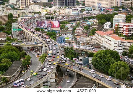 Bangkok - August 20 2015: Traffic moves slowly along a busy highway on August 20 2015 in Bangkok Thailand. Annually an estimated 150000 new cars join the already heavily congested streets of Bangkok.