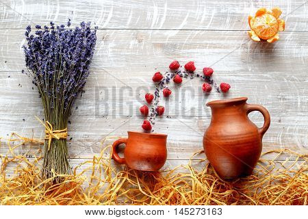 still life pottery and lavender - country life with berries on wooden background