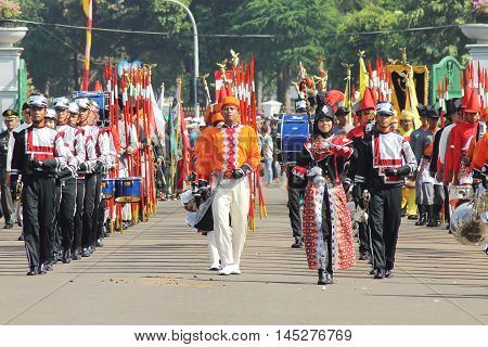 Jakarta, Indonesia - August 17, 2016: Marching band group who take part in the independence day flag ceremonial at Indonesian Presidential Palace marching.