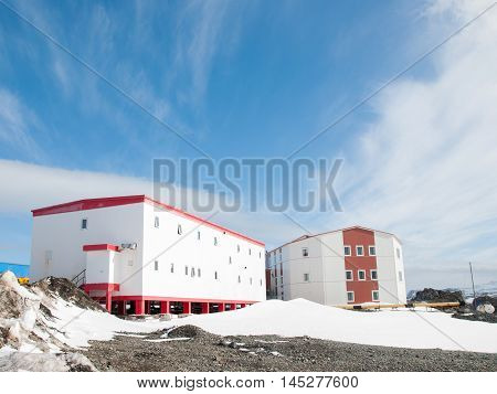 Research building on the snow and blue sky background, Antarctica