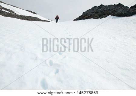 The hiker and footprint on the snow background at Antarctica
