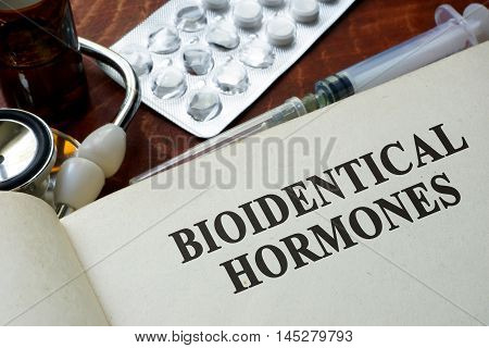 Book with words bioidentical hormones on a table.
